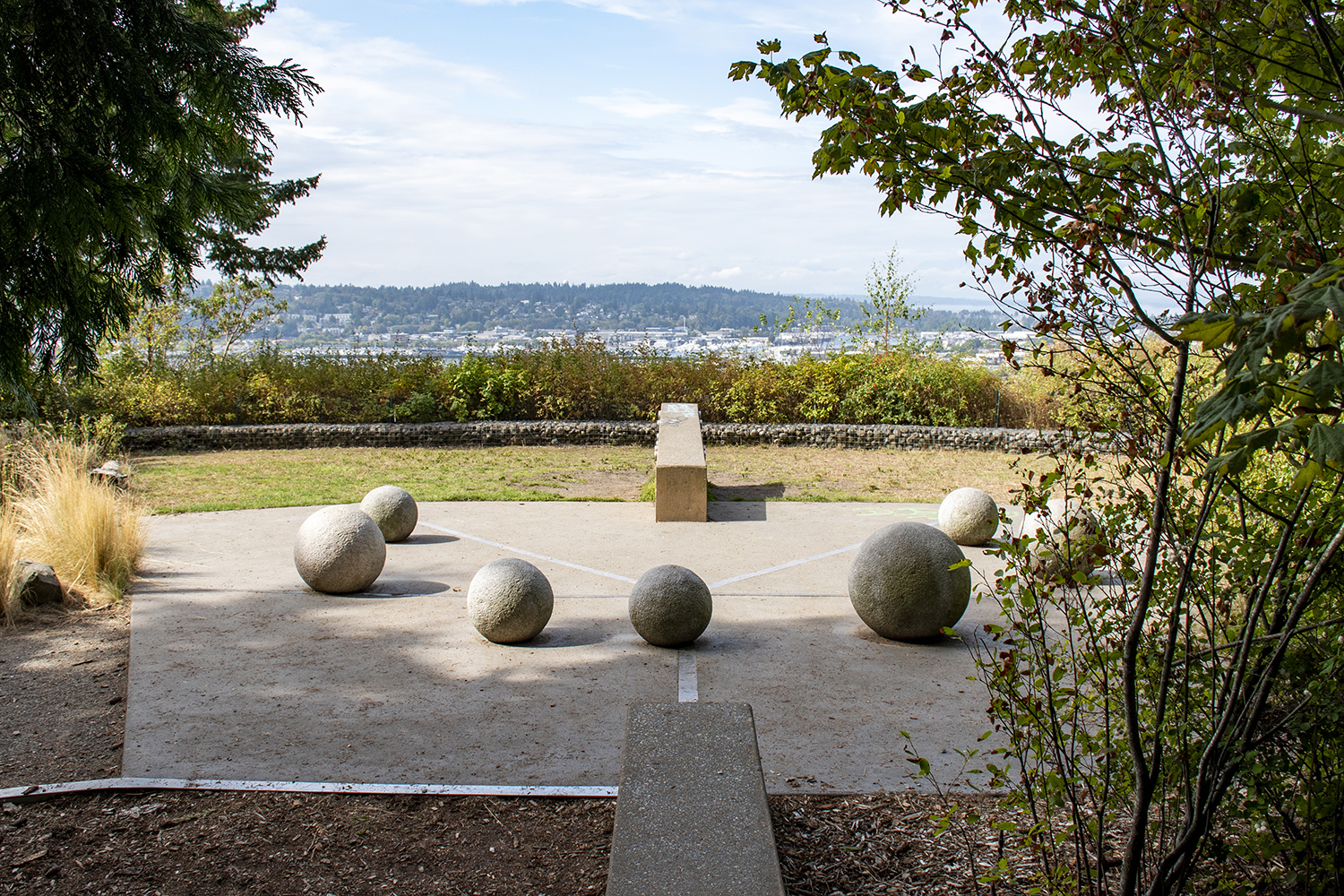 Located on a bluff, Fremont Peak Park offers visitors a half-acre park with elevated views of the Puget Sound and the Olympics. Enjoy the landscaped meadow, spherical art installations and sunset views from this tiny upper Fremont spot.{ }(Image: Rachael Jones / Seattle Refined)