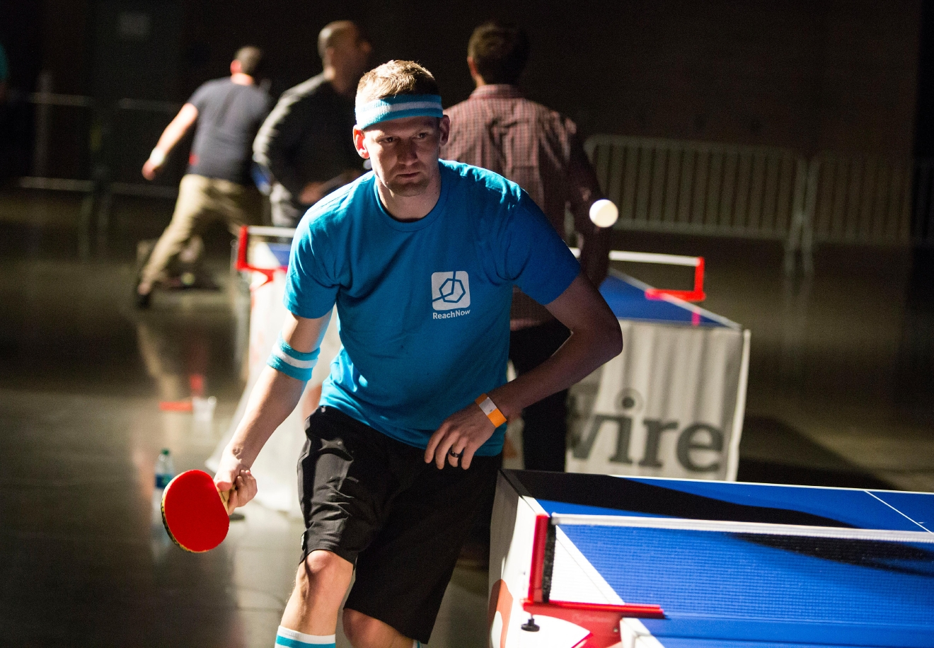 James Rachner, representing his company Reach Now, returns the ping pong ball during a friendly game against a coworker at the 6th annual Geekwire Bash at the CenturyLink Event Center. (Sy Bean / Seattle Refined)