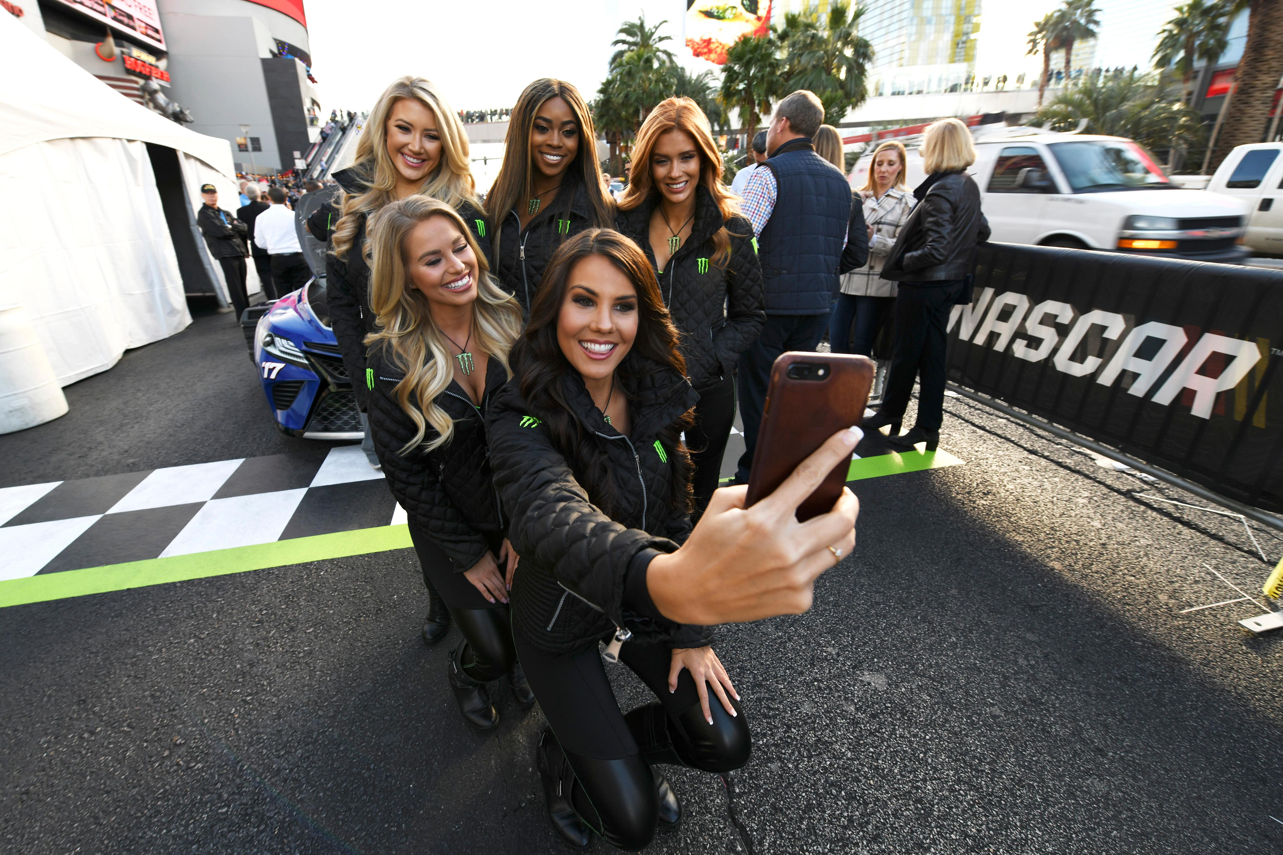 Monster Energy drink models pose for a photo during the NASCAR Victory Lap on the Las Vegas Strip being held as part of Champions Week Wednesday, November 29, 2017. CREDIT: Sam Morris/Las Vegas News Bureau