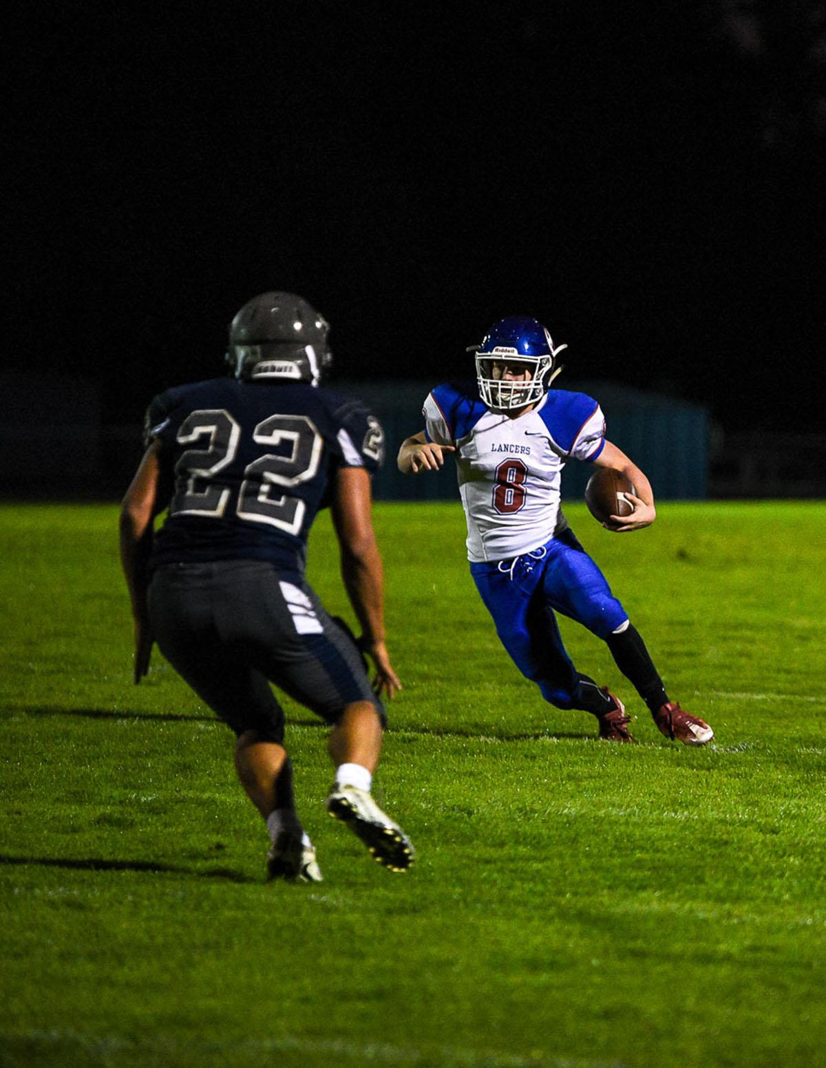 Churchill running back Dalton McDaniel (#8) rushes for a gain in the Lancer's 56-7 victory over Springfield remaining 7-0 on the season. Photo by Jeff Dean, Oregon News Lab