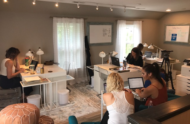 Dostal House founder, Meegan Hofmeister, WRITTEN Apparel's Emily Carlson and Dollup Beauty's Nikki Hynek share co-working space with two interns on a recent work day.