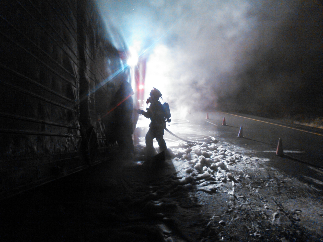 A trailer full of pineapples caught fire on Interstate 5 northbound early Friday morning. (Photos courtesy Coburg Fire)