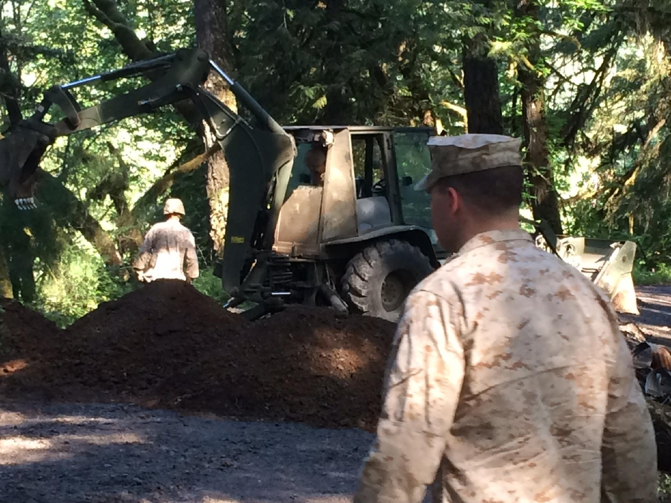 The Marines are fixing roads, replacing culverts and cutting down hazard trees along North Shore Road, a gravel road that borders the Middle Fork of the Willamette River across from Highway 58. (SBG)