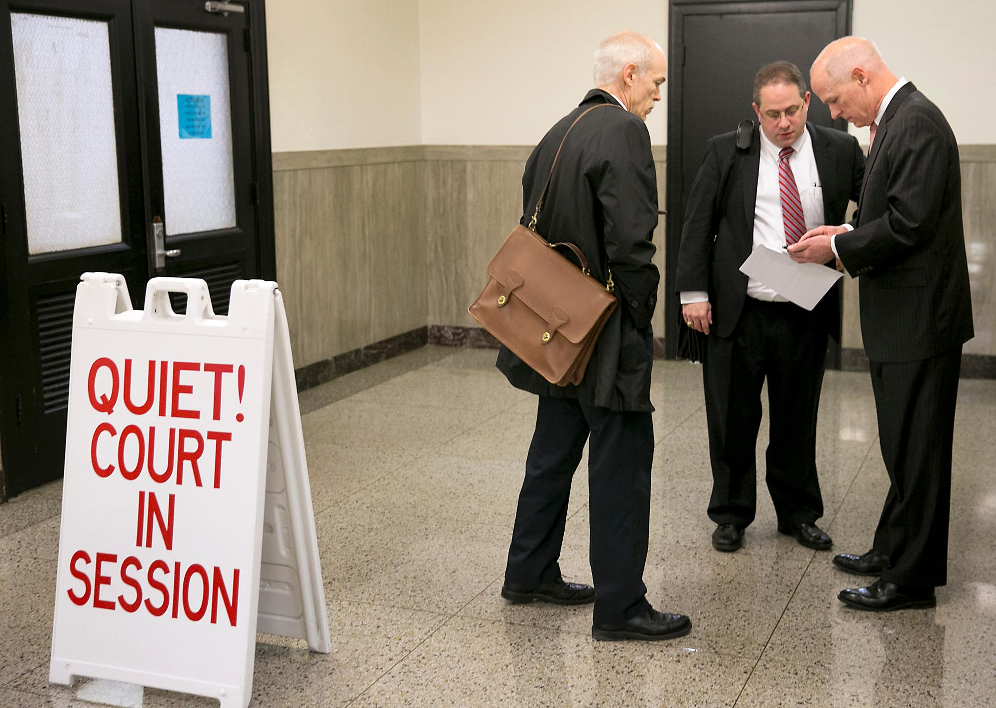 In this Feb. 3, 2015, photo, Trey Trainor, center, attorney for lobbyist James Frinzi, speaks with attorneys Clark Richards, left, and Dan Richards, right, who are representing Austin technology company 21CT in its lawsuit agains Frinzi, after a hearing at the Travis County Courthouse in Austin, Texas. The White House announced on Tuesday, Sept. 13, 2017, that President Donald Trump has appointed Trainor, a well-known election-law lawyer based in Austin, to the Federal Election Commission. (Ralph Barrera/Austin American-Statesman via AP)