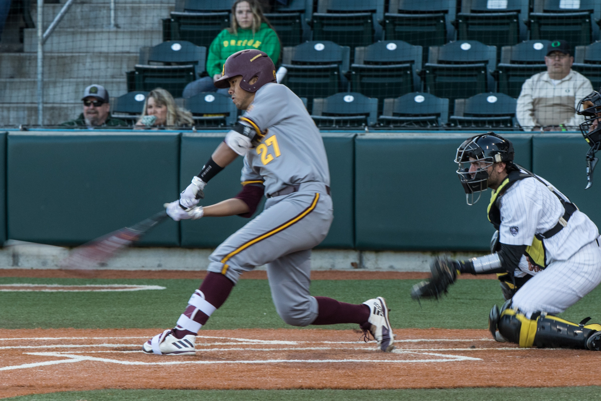 Arizona State Sun Devils catcher Lyle Lin (#27) hits the ball up and to an outfielder. The Oregon Ducks defeated the Arizona State Sun Devils 2-0 in the first game of a three game series Friday evening at PK Park in Eugene, Oregon.  Photo by Austin Hicks, Oregon News Lab