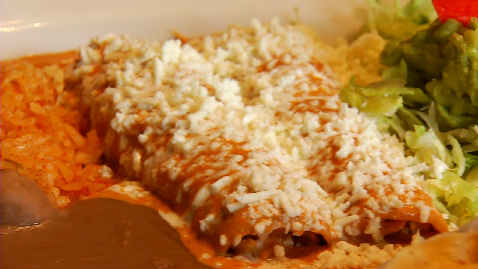 These are enchiladas en chipotle served with beans, rice, and lettuce, a very popular dish.{&amp;nbsp;} (SBG Photo)<p></p>