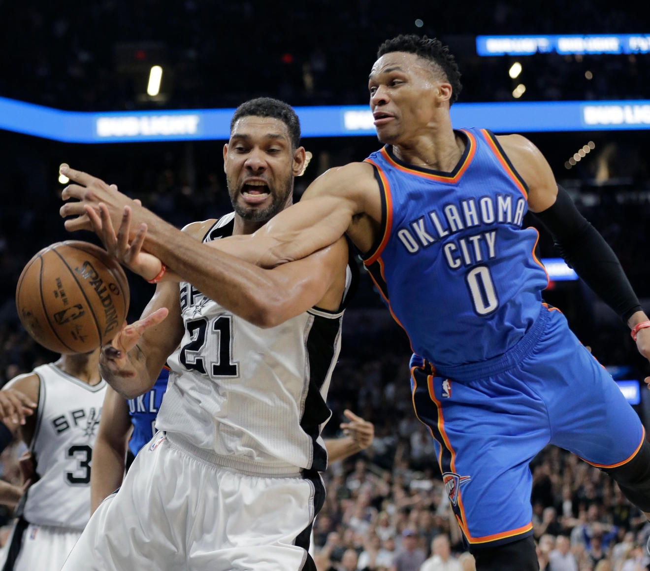 San Antonio Spurs forward Tim Duncan (21) and Oklahoma City Thunder guard Russell Westbrook (0) chase a loose ball during the second half in Game 5 of a second-round NBA basketball playoff series, Tuesday, May 10, 2016, in San Antonio. Oklahoma City won 95-91. (AP Photo/Eric Gay)