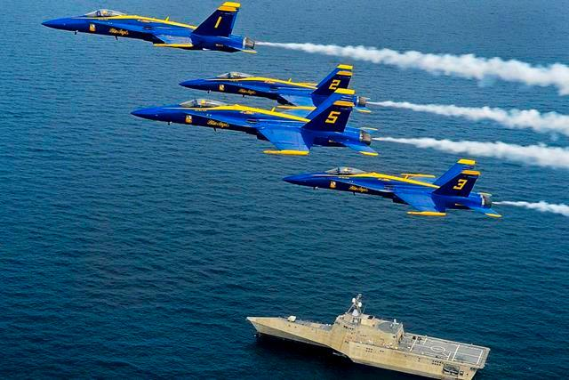 F/A-18 Hornets from the Blue Angels, the Navy's flight demonstration squadron, fly over the littoral combat ship Pre-Commissioning Unit Coronado during a training flight over the Gulf of Mexico, Aug. 1, 2013.