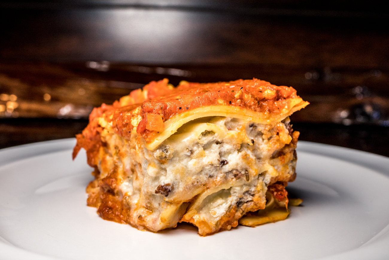Meat Lasagna: lasagna layered with chopped sausage, crushed meatballs, small-batch marinara sauce, mozzarella, and ricotta / Image: Catherine Viox{ }// Published: 2.3.20