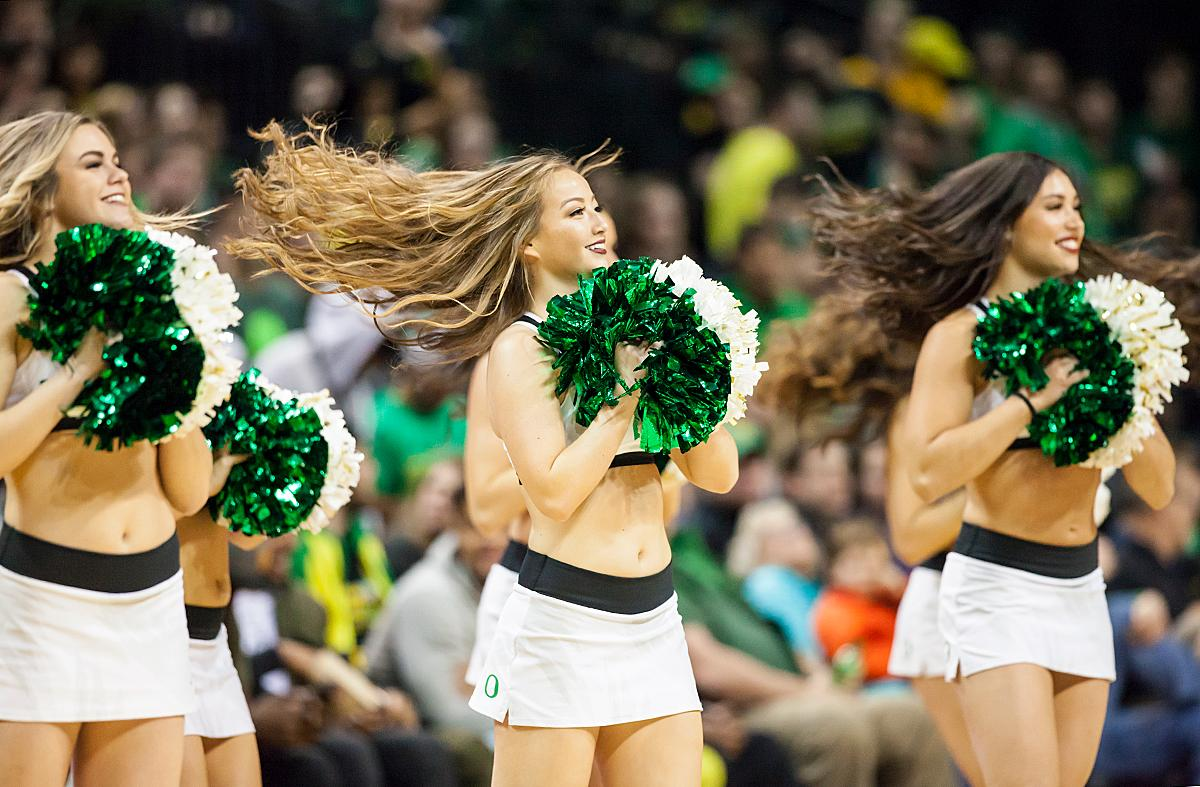 Them members of the University of Oregon cheer team entertains the crowd during a timeout. The Oregon Ducks defeated the Arizona State Sun Devils 71 to 70. Photo by Ben Lonergan, Oregon News Lab