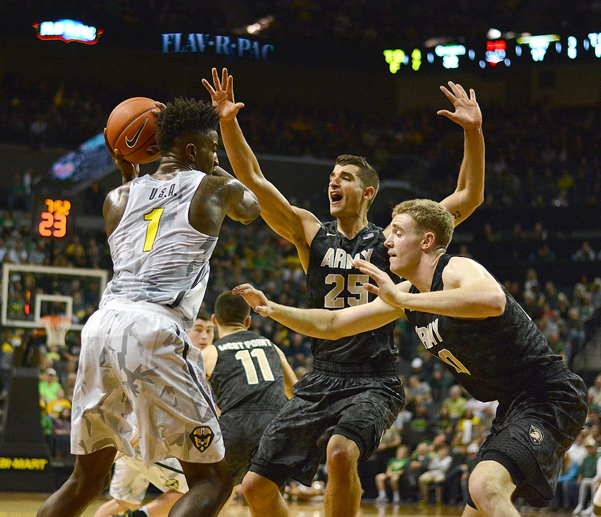 Ducks' Jordan Bell (#1) protects the ball under high pressure from Army's Luke Morrison (#25) and Mac Hoffman (#20). In front of a sold out crowd, Oregon defeated Army 91-77 on opening night. Photo by Jacob Smith, Oregon News Lab