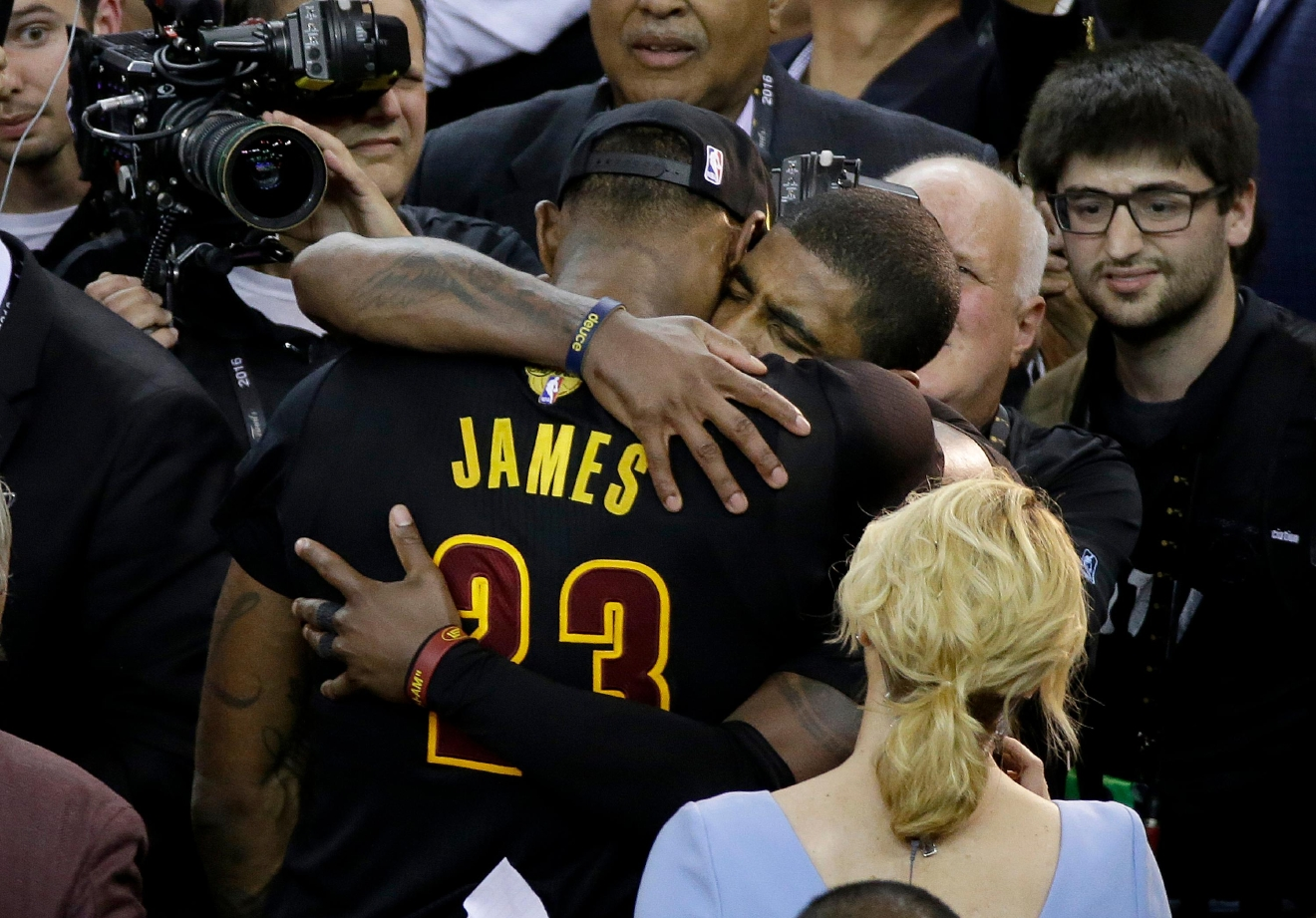 Cleveland Cavaliers forward LeBron James (23) hugs Kyrie Irving after Game 7 of basketball's NBA Finals against the Golden State Warriors in Oakland, Calif., Sunday, June 19, 2016. The Cavaliers won 93-89. (AP Photo/Eric Risberg)