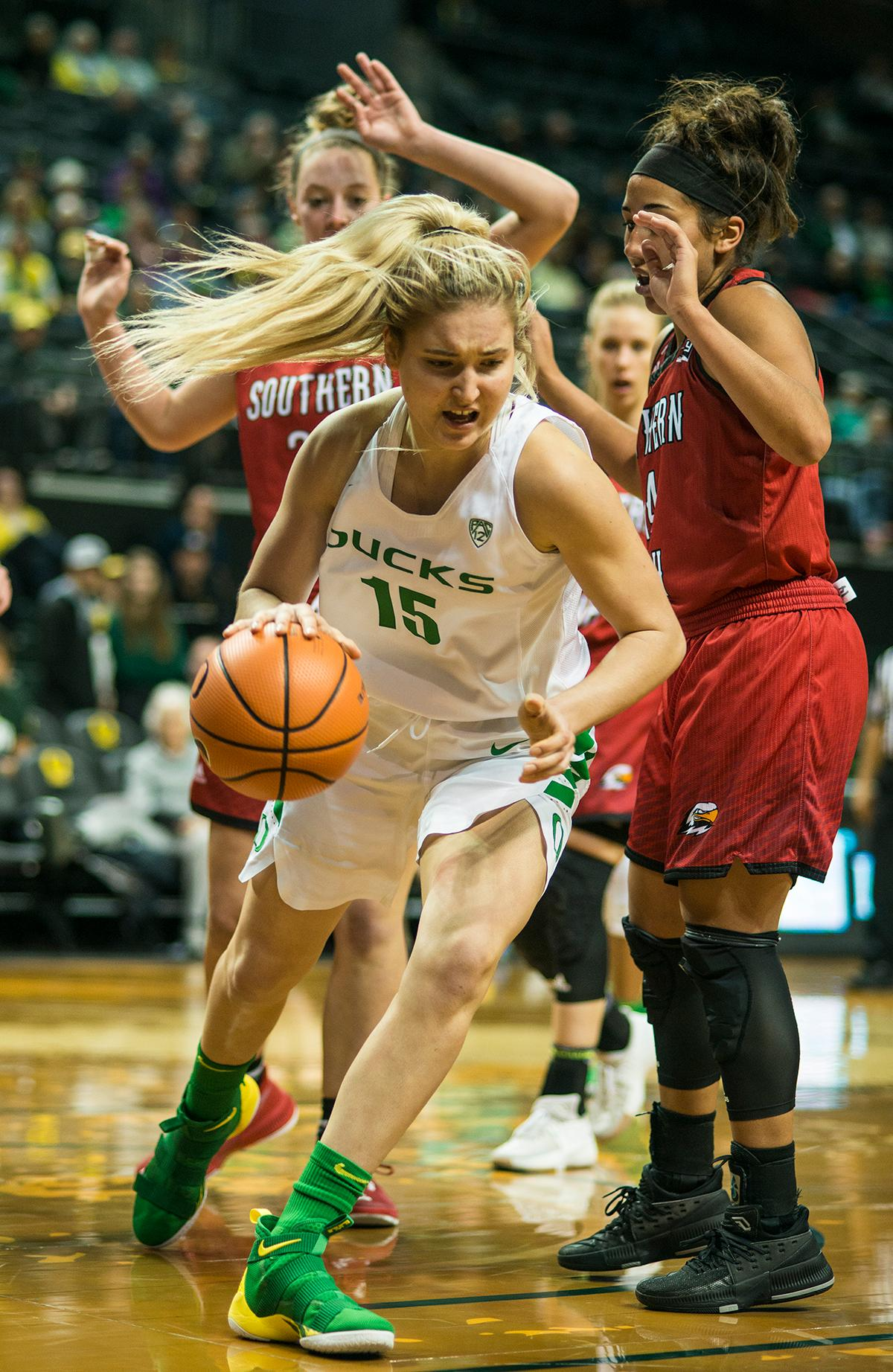 Oregon Ducks Anneli Maley (#15) breaks away with the ball. The University of Oregon Ducks women basketball team defeated the Southern Utah Thunderbirds 98-38 in Matthew Knight Arena Saturday afternoon. The Ducks had four players in double-digits: Ruthy Hebard with 13; Mallory McGwire with 10; Lexi Bando with 17 which included four three-pointers; and Sabrina Ionescu with 16 points. The Ducks overwhelmed the Thunderbirds, shooting 50% in field goals to South Utah's 26.8%, 53.8% in three-pointers to 12.5%, and 85.7% in free throws to 50%. The Ducks, with an overall record of 8-1, and coming into this game ranked 9th, will play their next home game against Ole Miss on December 17. Photo by Rhianna Gelhart, Oregon News Lab