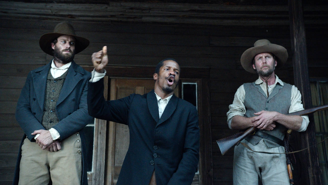 "In this image released by Fox Searchlight Pictures, from left, Armie Hammer portrays Samuel Turner, Nate Parker portrays Nat Turner and Jayson Warner Smith portrays Earl Fowler in a scene from ""The Birth of a Nation,"" opening Oct. 7, 2016. (Fox Searchlight Pictures via AP)"
