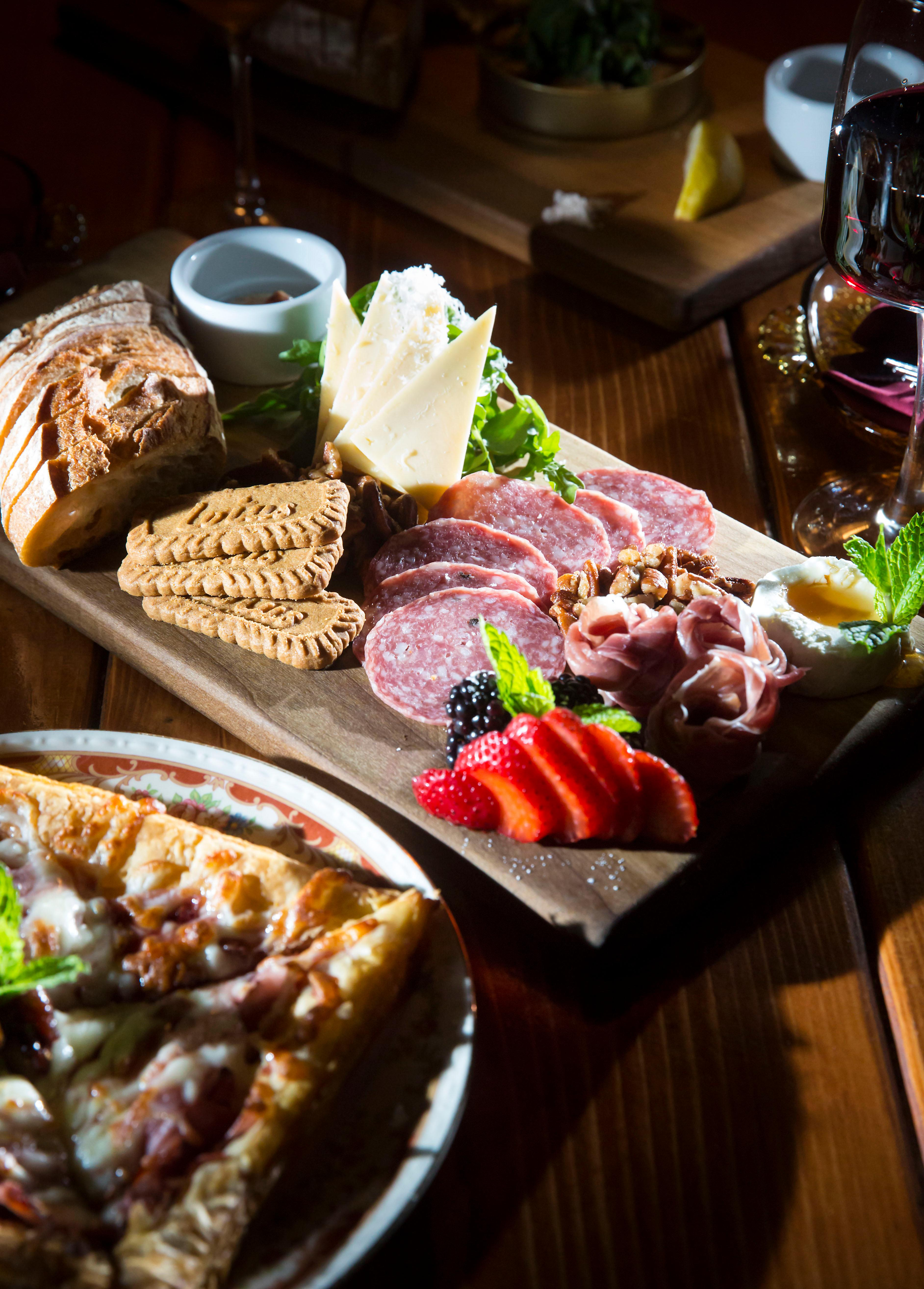 <p>&quot;The Picnic&quot;, filled with sweet and savory meats, cheeses, fruits and treats.</p><p>The Little Tin in Ballard opened in December 2016 and is becoming a quiet the little hot-spot. It's a quieter bar, in comparison to the bumping bar scene in Ballard. Neither a bar nor a restaurant, they instead call themselves a 'goods &amp;amp; apothecary cabinet'! The Little Tin is a place for people to gather around and enjoy delicious snacks and thoughtful, well-made cocktails. Can't be mad at that! (Image: Sy Bean / Seattle Refined)</p>