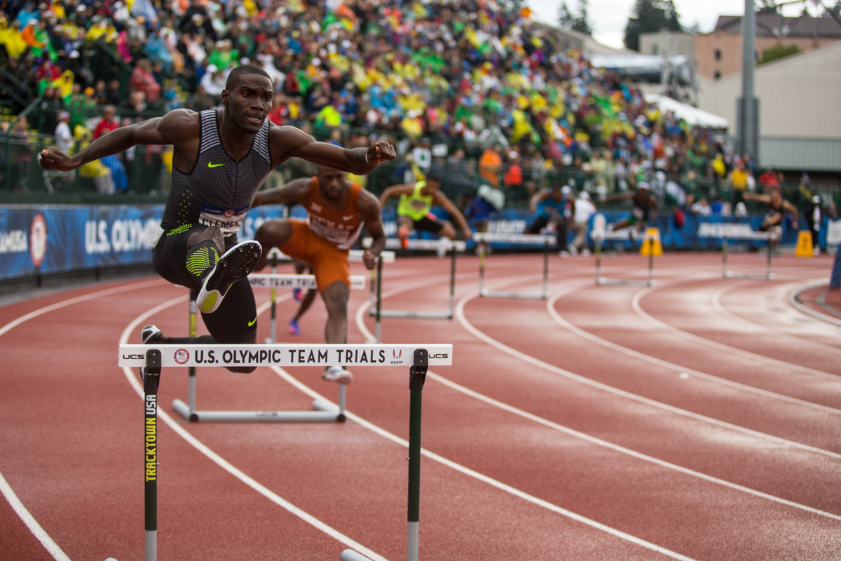 Kerron Clement leads the field on the first curve of the 400m hurdles. Photo by Dillon Vibes