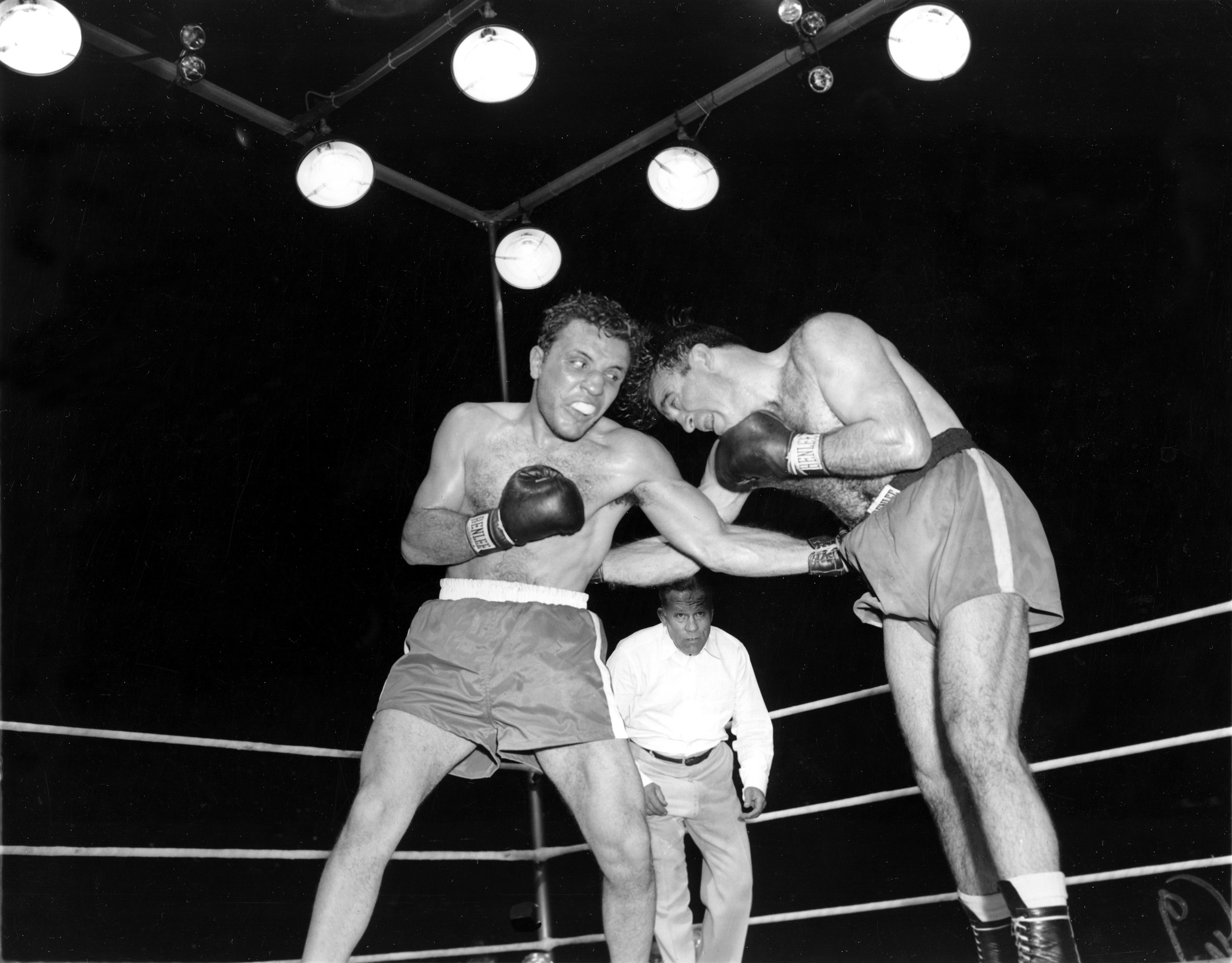 "FILE - In this June 16, 1949, file photo, Jake LaMotta, left, pounds Marcel Cerdan in third round of a world middleweight title bout in Detroit, Mich. LaMotta won the title by a knockout in the tenth round. LaMotta, whose life was depicted in the film ""Raging Bull,"" died Tuesday, Sept. 19, 2017, at a Miami-area hospital from complications of pneumonia. He was 95. (AP Photo/File)"