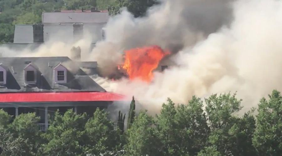 This photo was taken from a rooftop a few houses away from the Smith Street fire Friday afternoon. (Megan Rivers/WCIV)