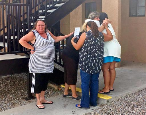 Women mourn near the apartment  in Albuquerque, N.M., Thursday, Aug. 25, 2016, where the body of a 10-year-old girl who police said was sexually assaulted, strangled then dismembered was found.  (AP Photo/Russell Contreras)