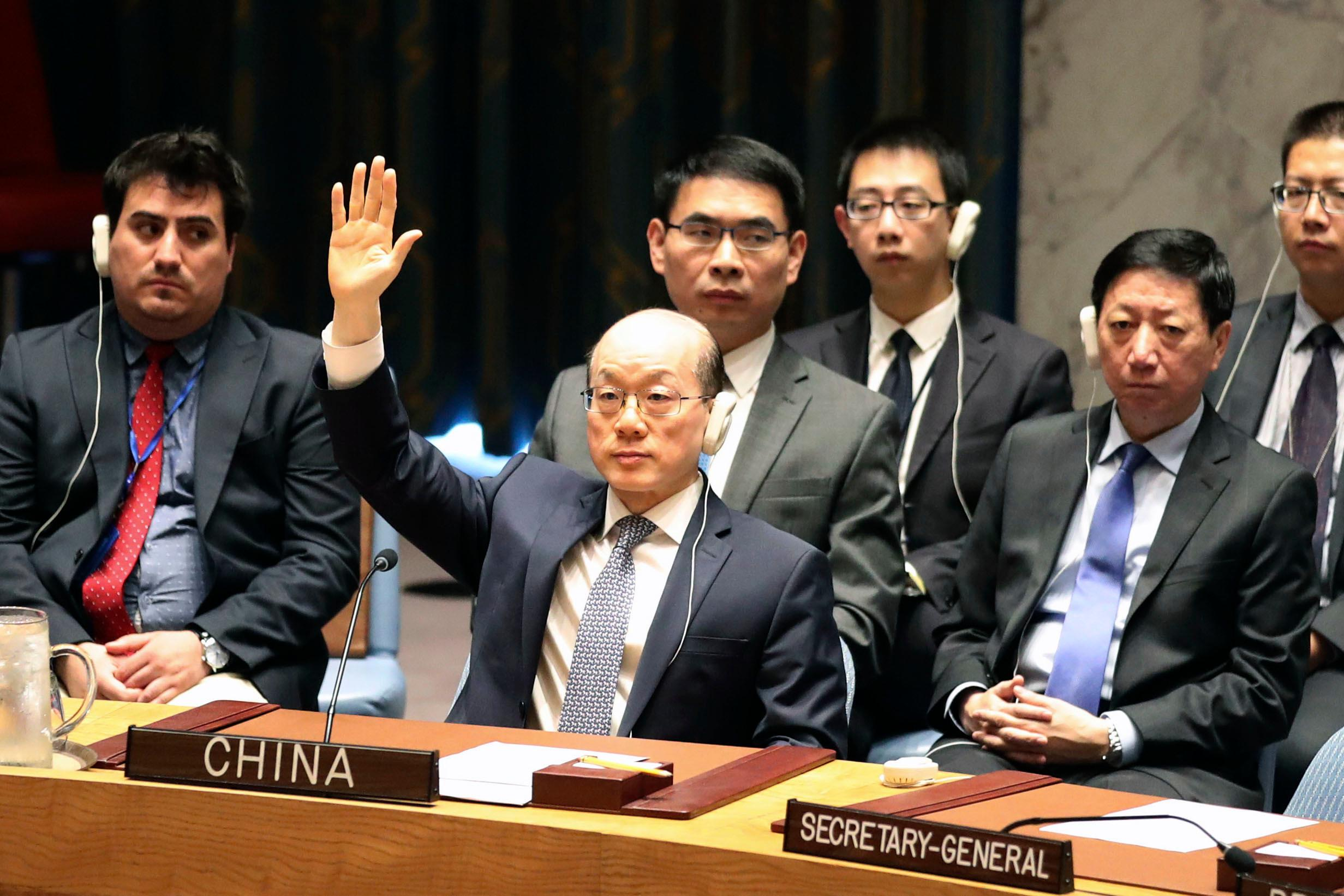 Chinese Ambassador to the United Nations Liu Jieyu votes during a Security Council meeting on a new sanctions resolution that would increase economic pressure on North Korea to return to negotiations on its missile program, Saturday, Aug. 5, 2017 at U.N. headquarters. (AP Photo/Mary Altaffer)