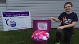 10-year-old Mars Hill cancer survivor raises funds, awareness with purple toilet