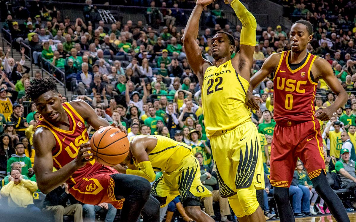 The Trojan's Jonah Mathews (#2) falls backwards after making a rebound. The UO Ducks basketball team suffered a loss to the USC Trojans, 75-70, at Matthew Knight Arena on Thursday. Payton Pritchard lead the scoring with 18 points. The Ducks are now 2-4 in conference play and 12-7 overall. The Ducks will next play the UCLA at Matthew Knight Arena at 7:15 p.m. on Saturday, Jan. 20. Photo by August Frank, Oregon News Lab