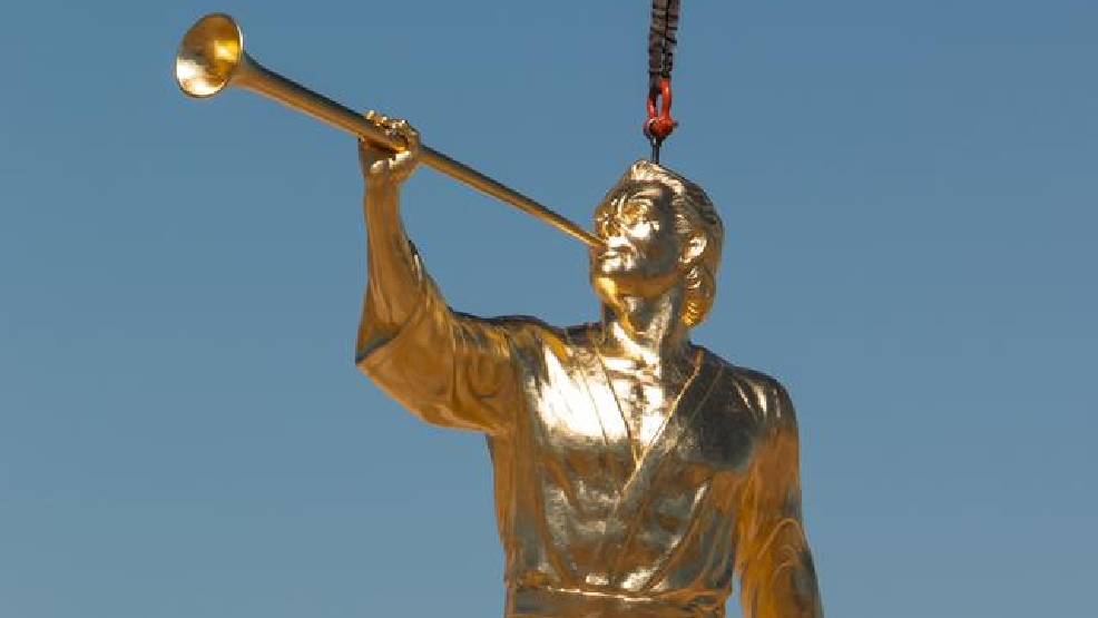 crowd watches in cedar city as angel moroni placed on new lds temple