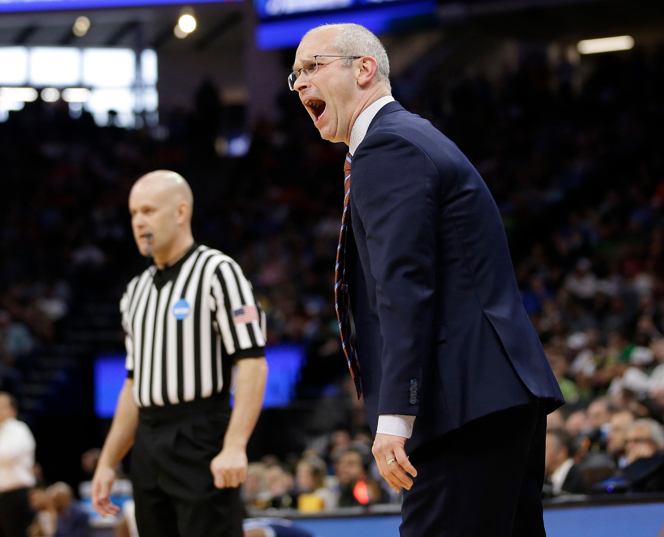 Rhode Island oach Dan Hurley yells instructions to his players during the first half against Oregon in a second-round game of the NCAA men's ollege basketball tournament in Sacramento, Calif., Sunday, March 19, 2017. (AP Photo/Rich Pedroncelli )