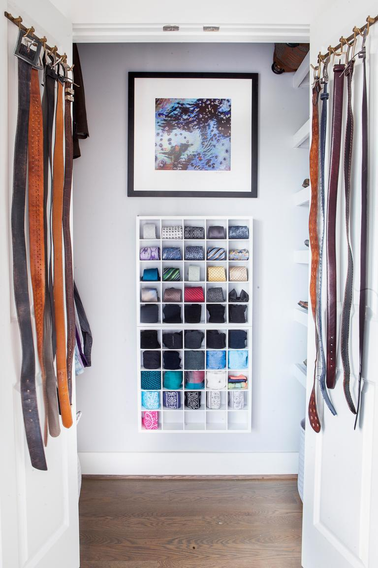 9. Fill with clothes: Place all clothing and accessories back into the closets, maybe hang a piece of art on the wall to finish the space off and ENJOY your beautiful new closet! (Image: Ashley Hafstead