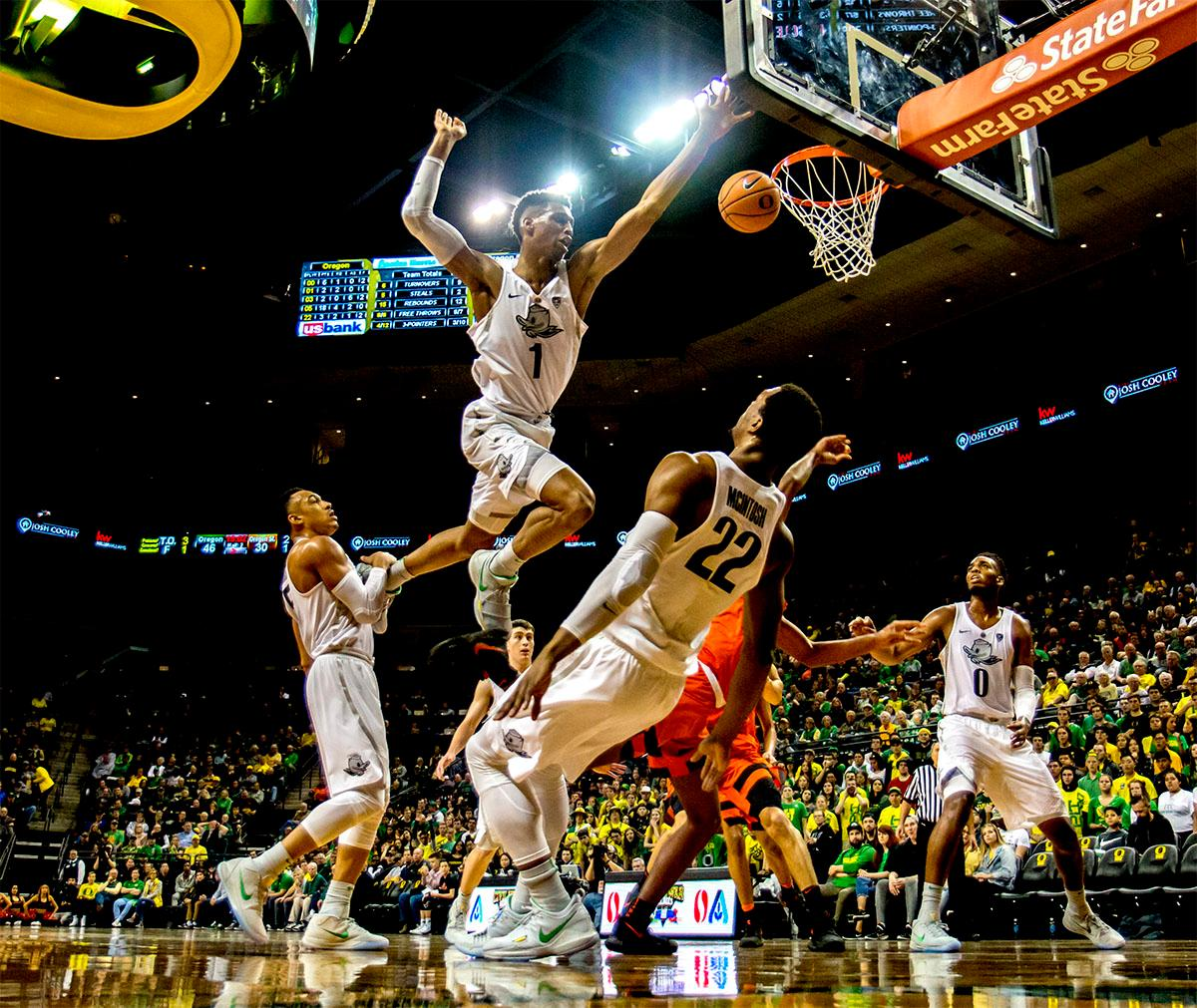 The Duck's Kenny Wooten (#1) flies high as he attempts to defend the basket against the Beavers. The Ducks defeated the Beavers in the civil war game, 66-57, at Matthew Knight Arena on Saturday night. Elijah Brown scored a game high of 20 points with 18 of the points coming in the first half, Paul White added 17 points. The Ducks are now 14-7 overall and 4-4 in conference play. The Ducks will next face California on Thursday Feb. 1 at 6:00 p.m. Photo by August Frank, Oregon News Lab