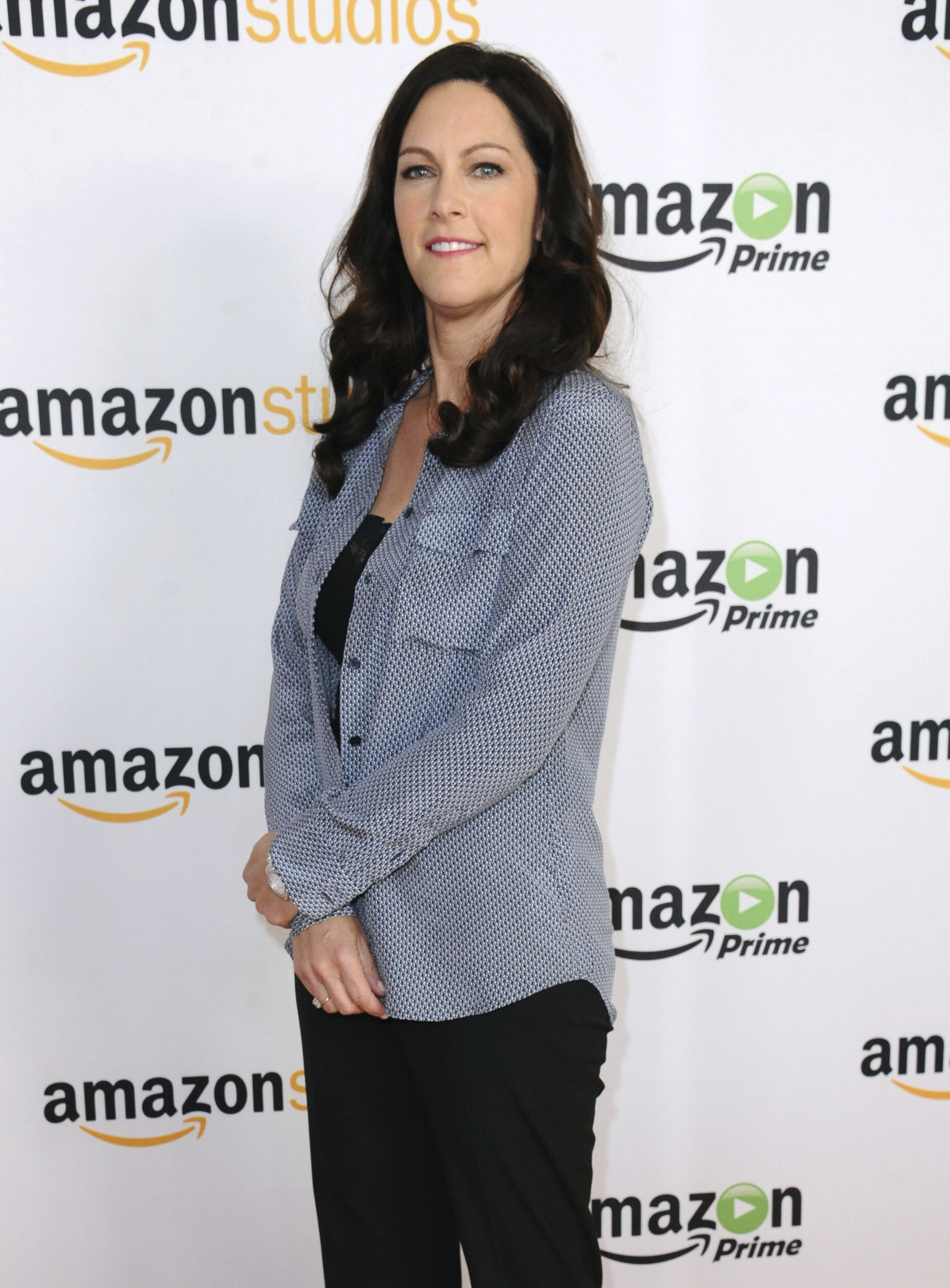 "FILE - In this Aug. 3, 2015 file photo, producer Isa Dick Hackett attends ""The Man in the High Castle"" photo call at the Amazon Summer TCA Tour at the Beverly Hilton Hotel in Beverly Hills, Calif. Another powerful Hollywood executive is facing allegations of sexual harassment. Hackett, a producer on an Amazon series, claims that Amazon Studios chief Roy Price propositioned her using crudely suggestive language. (Photo by Richard Shotwell/Invision/AP, File)"
