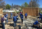 Volunteers carry studs at a National Women Build Week event at a Habitat for Humanity build in Green Bay May 8, 2017.
