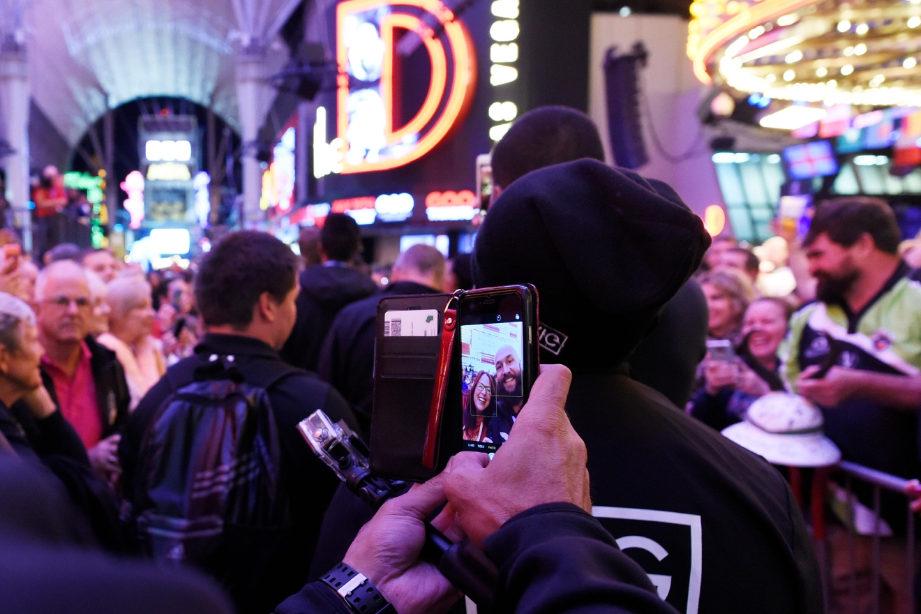 "A player from the New Zealand national team takes a selfie with a fan during the USA Sevens rugby ""Parade of Nations"" Thursday, March 3, 2017, at the Fremont Street Experience. CREDIT: Sam Morris/Las Vegas News Bureau"