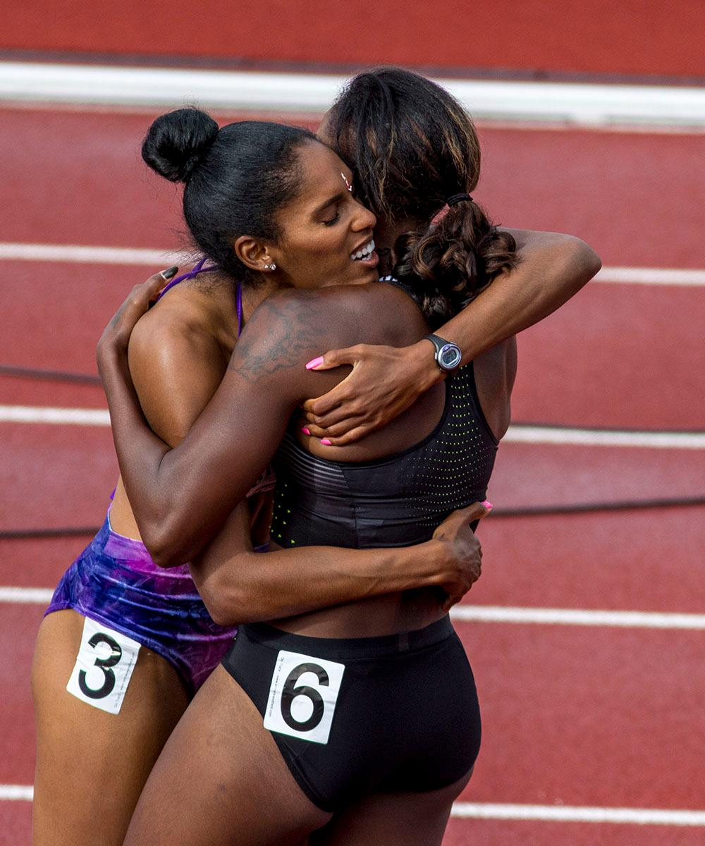 Kristi Castlin, left, and Nia Ali, right, embrace after realizing they qualified for the Rio Olympics in the Women�s 100m Hurdle. Castlin finished second with a time of 12.50. Ali finished third with a time of 12:55. Day eight of the U.S. Olympic Track and Field Trials took place Friday at Hayward Field in Eugene, Ore. Events continue through July 10. (Photo by Amanda Butt)