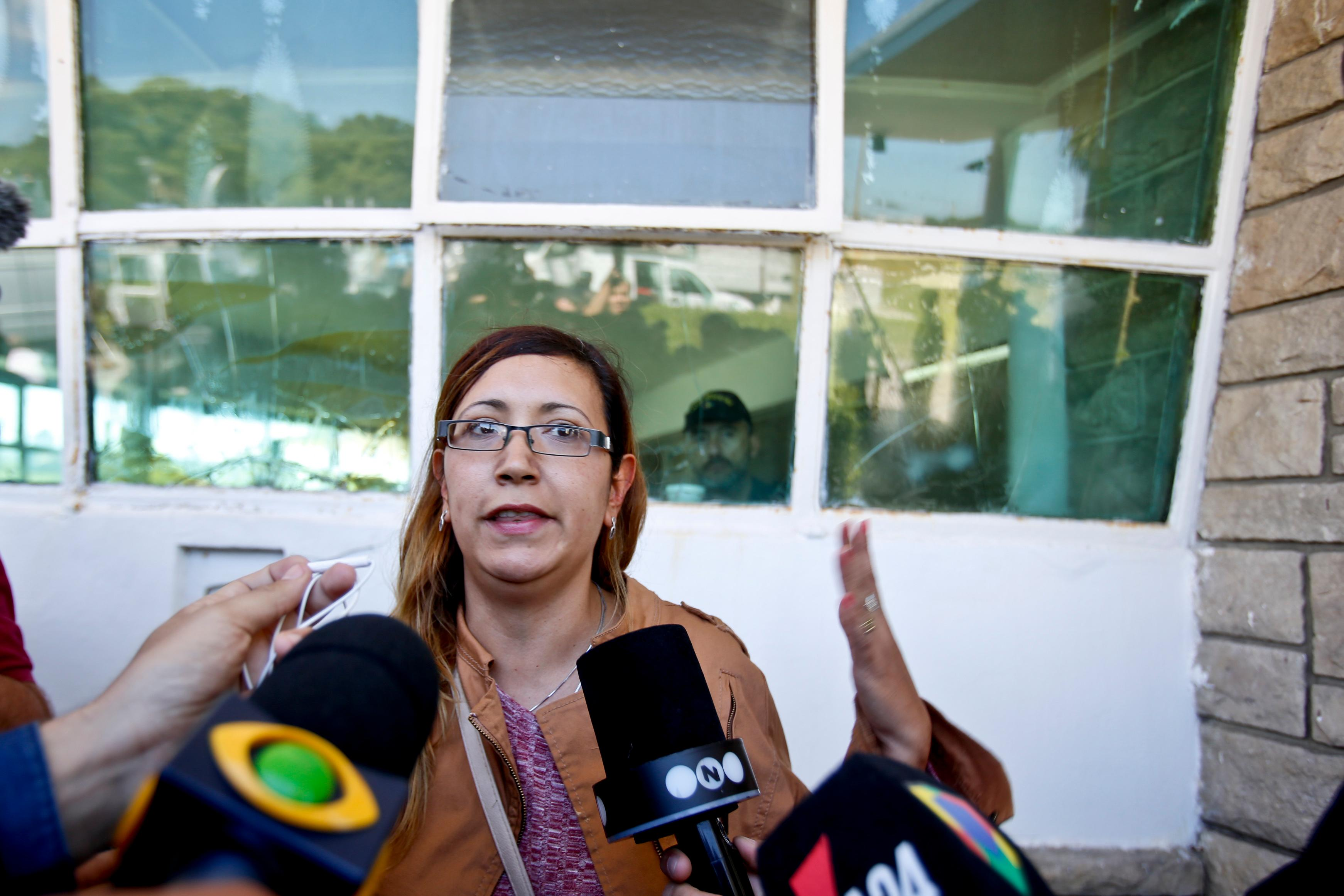 "Itati Leguizamon, wife of submarine crew member German Suarez, speaks with the media after relatives were told that a sound detected during the search for the ARA San Juan submarine is consistent with that of an explosion, at the Mar de Plata Naval Base, in Argentina, Thursday, Nov. 23, 2017.  ""They sent a piece of crap to sail,"" said Leguizamon. ""They inaugurated a submarine with a coat of paint and a flag in 2014, but without any equipment inside. The navy is to blame for its 15 years of abandonment."" (AP Photo/Esteban Felix)"