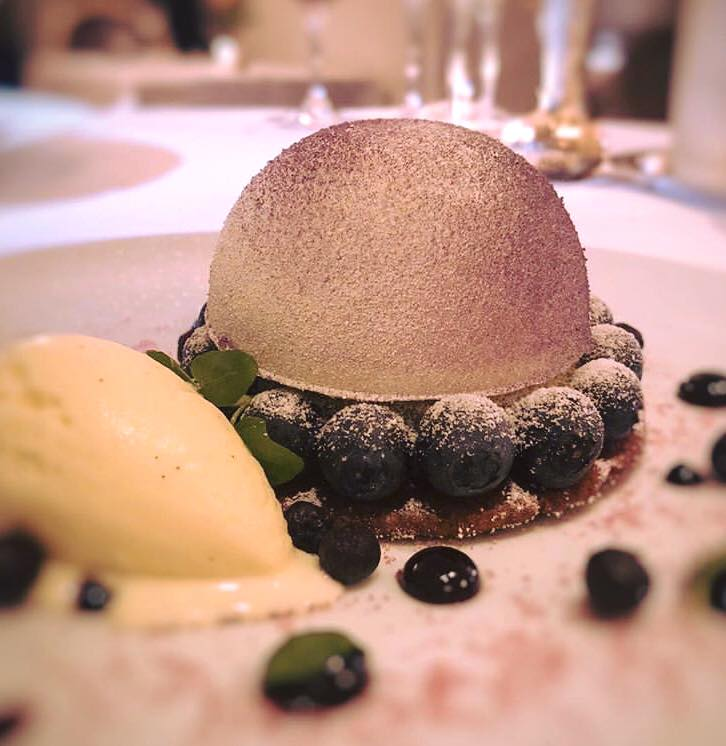 The Michelin-starred kitchen at Plume offers a light flavor for the palette with violet frozen marshmallow and vanilla ice cream, along with lemon and blueberry in the meyer lemon blueberry shortbread. Perfect for warmer days! (Image: Courtesy Plume)<p></p>