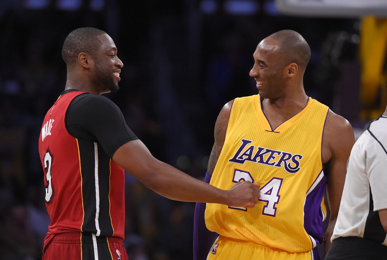 Miami Heat guard Dwyane Wade, left, and Los Angeles Lakers forward Kobe Bryant greet each other prior to an NBA basketball game Wednesday, March 30, 2016, in Los Angeles. (AP Photo/Mark J. Terrill)