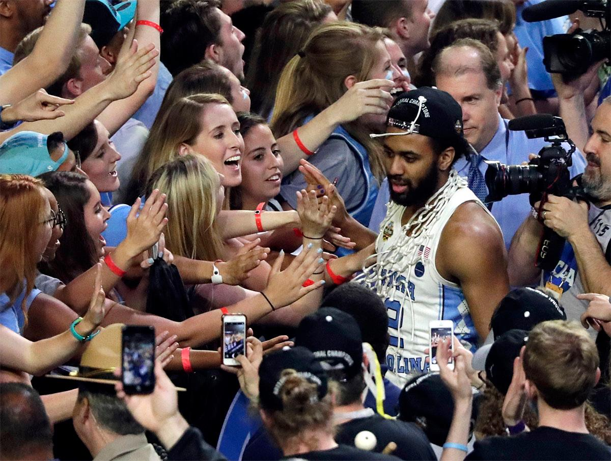 North Carolina guard Joel Berry II celebrates with fans after the championship game against Gonzaga at the Final Four NCAA college basketball tournament, Monday, April 3, 2017, in Glendale, Ariz. North Carolina 71-65. (AP Photo/Matt York)