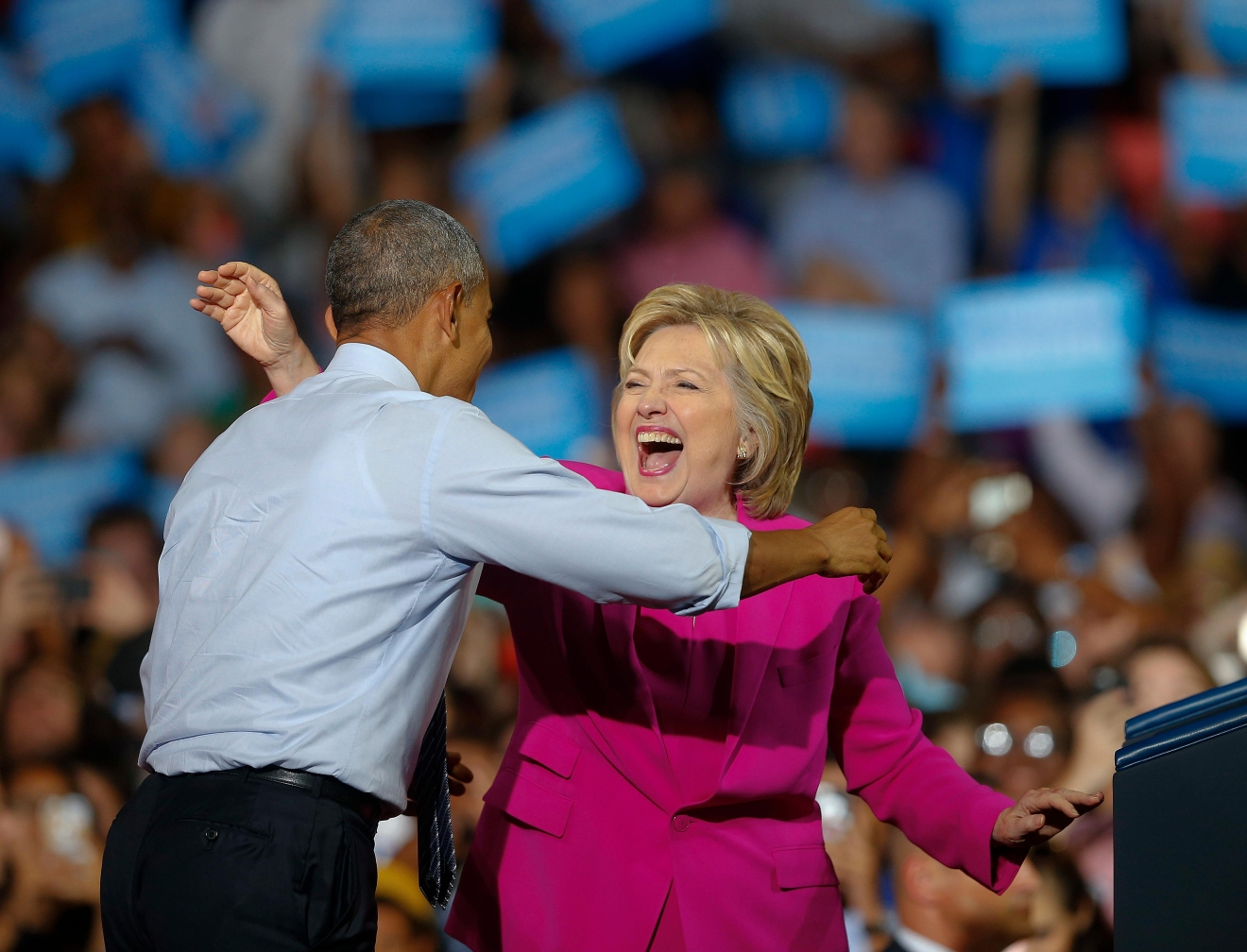 President Barack Obama and Democratic presidential candidate Hillary Clinton embrace during a campaign rally, Tuesday, July 5, 2016, in Charlotte, N.C.. (AP Photo/John Bazemore)
