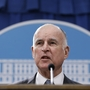 Brown swipes Trump for border wall, says California to fight
