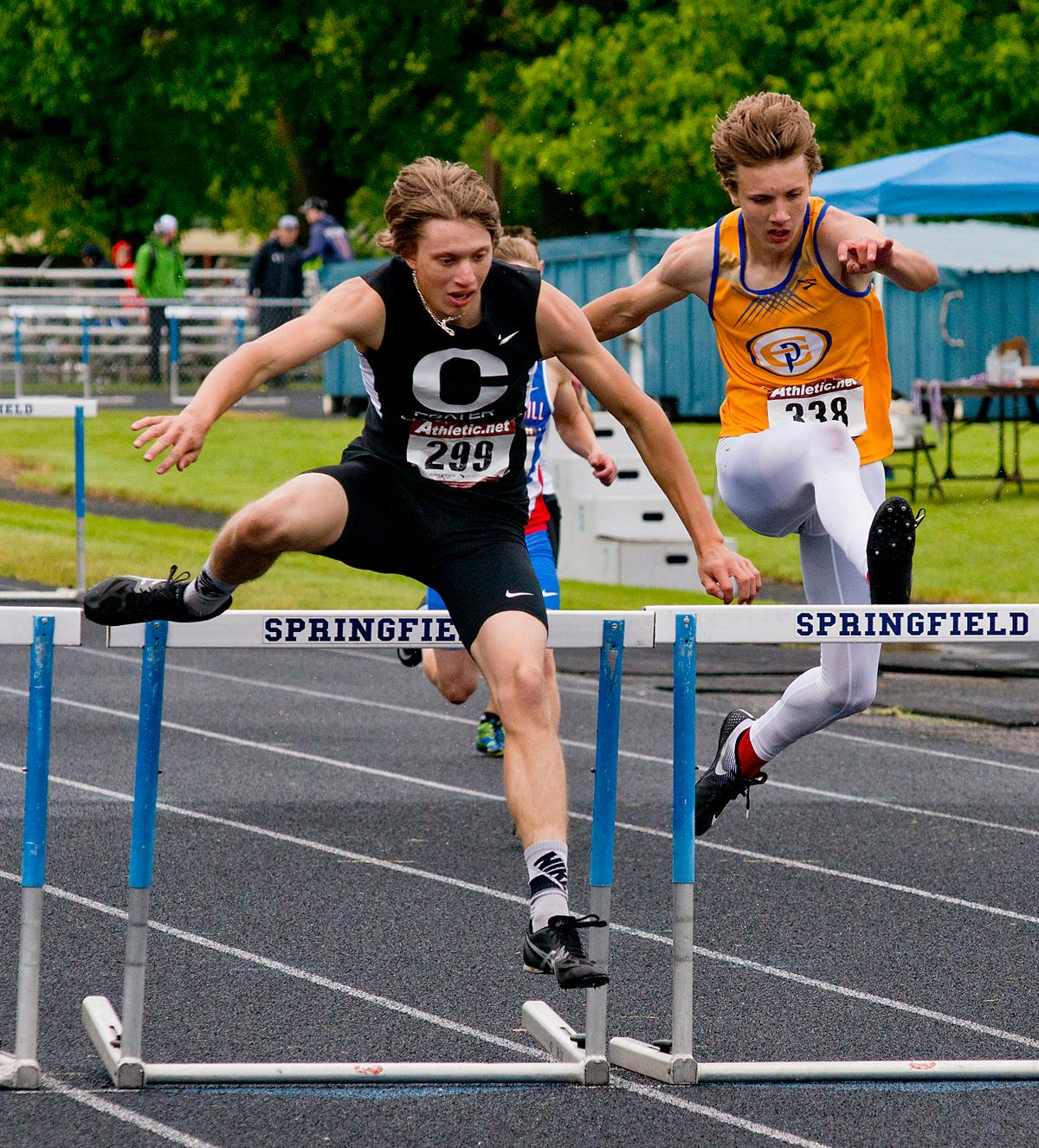 Cal Duke from Crater wins the 300 meter hurdles with a time of 40.70 at the 5A-3 Midwestern League District Track Meet. Photo by Dan Morrison, Oregon News Lab