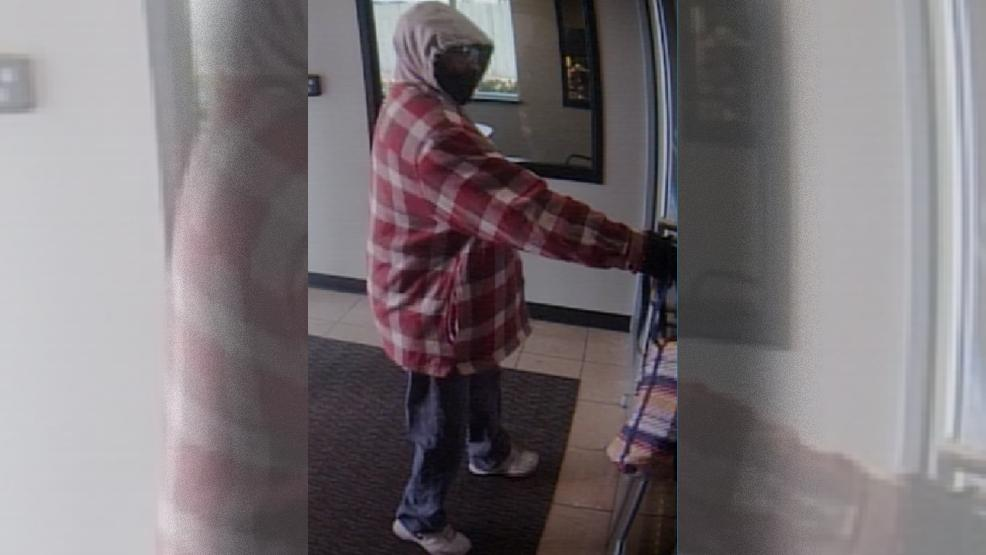 Bank robbery suspect caught on surveillance cameras at Arvest Bank near 91st and Delaware March 8, 2018. (TPD)
