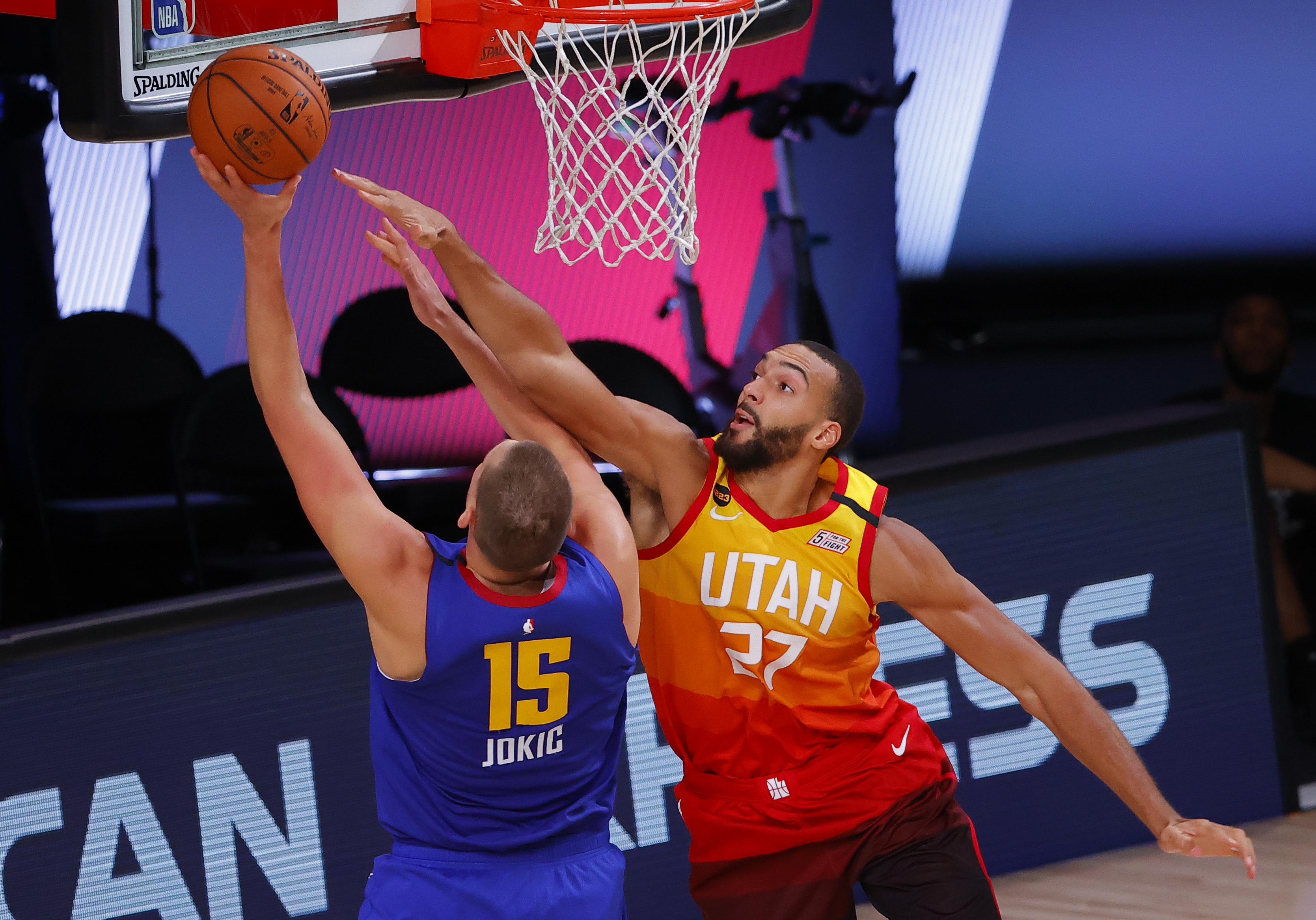 Utah Jazz's Rudy Gobert, right, defends against Denver Nuggets' Nikola Jokic during the third quarter of Game 4 of an NBA basketball first-round playoff series, Sunday, Aug. 23, 2020, in Lake Buena Vista, Fla. (Kevin C. Cox/Pool Photo via AP)