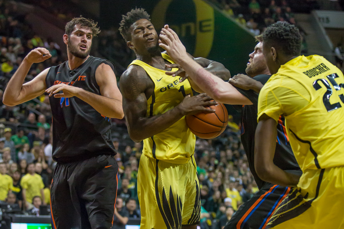 Oregon forward Jordan Bell (#1) takes a fist to the face in the middle of a scuffle for the ball. After trailing for most of the game, the Oregon Ducks defeated the Boise State Broncos 68-63. Photo by Dillon Vibes