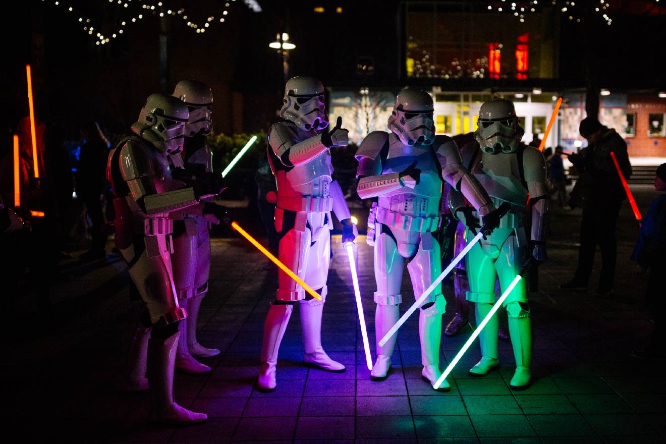 Hundreds of Star Wars fans gathered under the Space Needle to hold a lightsaber vigil for the late Carrie Fisher. Fans dressed as Star Wars characters including Princess Leia who Carrie Fisher portrayed. The vigil included a moment of silence and lightsaber duels. (Image: Joshua Lewis / Seattle Refined)