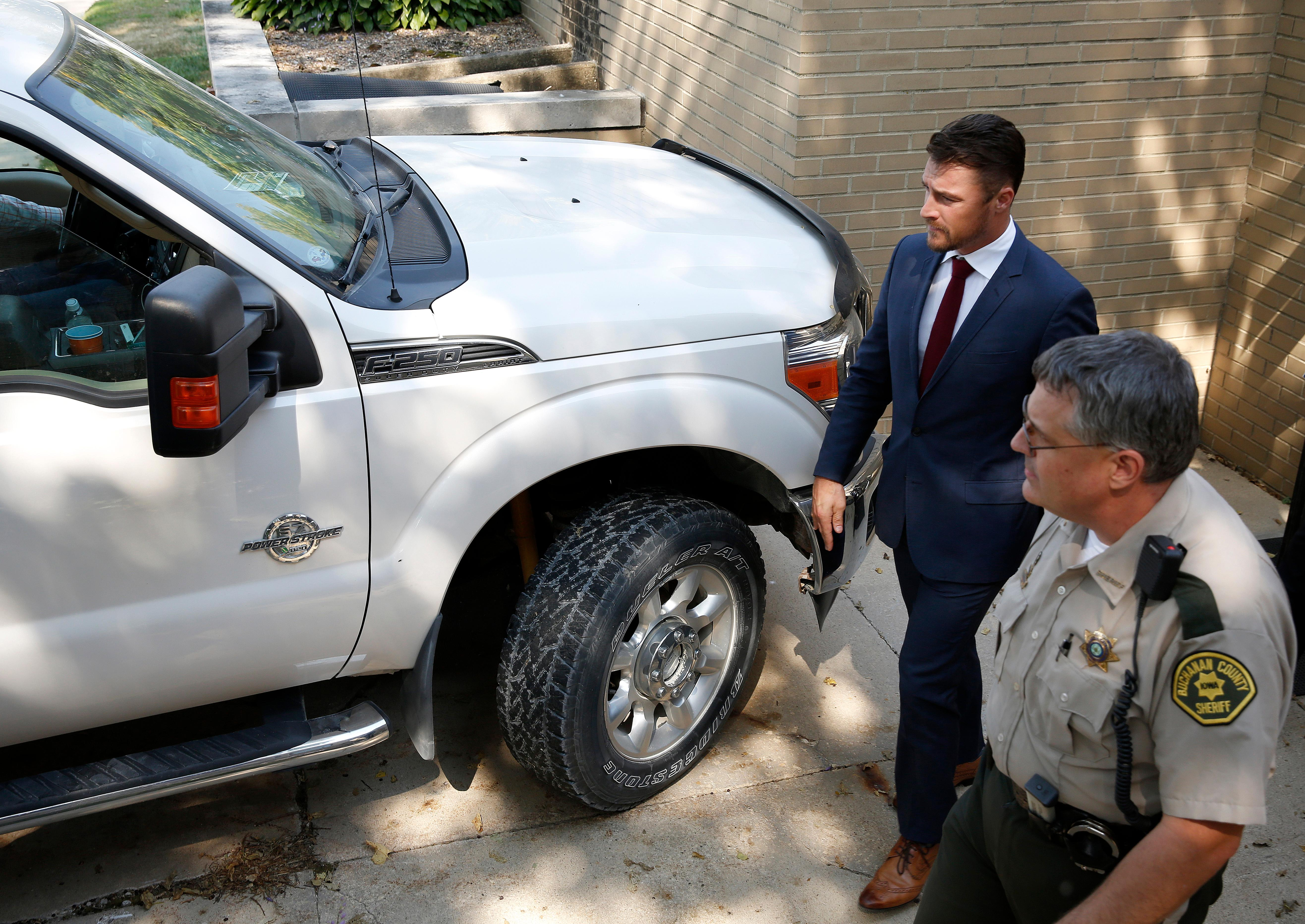 Chris Soules heads to his fathers truck after a hearing in Buchanan County District Court Thursday, Sept. 14, 2017, in Independence, Iowa. Reality TV star Soules is charged with leaving the scene in a fatal April crash near Aurora, Iowa. (MATTHEW PUTNEY, The Courier /POOL)