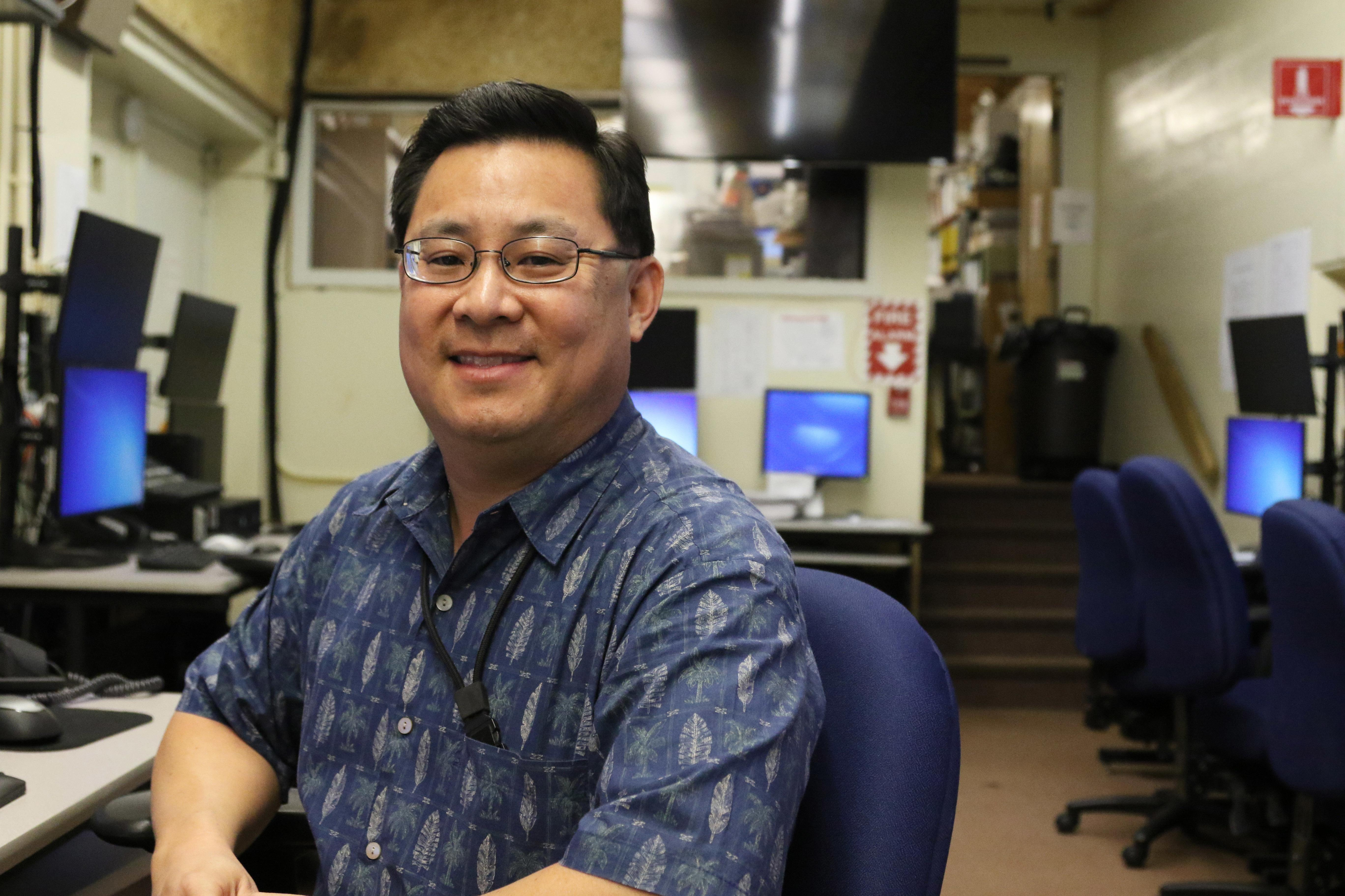 "In this Feb. 1, 2018 photo, Jeffrey Wong, current operations officer for the Hawaii Emergency Management Agency, poses for a photo in Honolulu. He filed a police report after seeing threatening comments online from people who confused him with being the agency employee who mistakenly sent a missile alert. He wants to set the record straight that he's not the so-called ""button-pusher"" and was on a different island when the alert was sent from Honolulu on Jan. 13. (AP Photo/Jennifer Sinco Kelleher)"