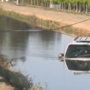 SUV crashes into power pole, ends up in canal