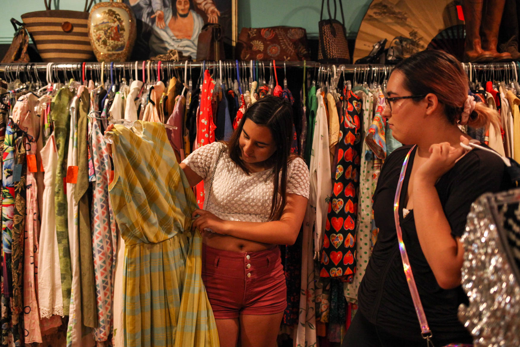 Isabella, left, and Alysia, right, shop in Baltimore. (Amanda Andrade-Rhoades/DC Refined)