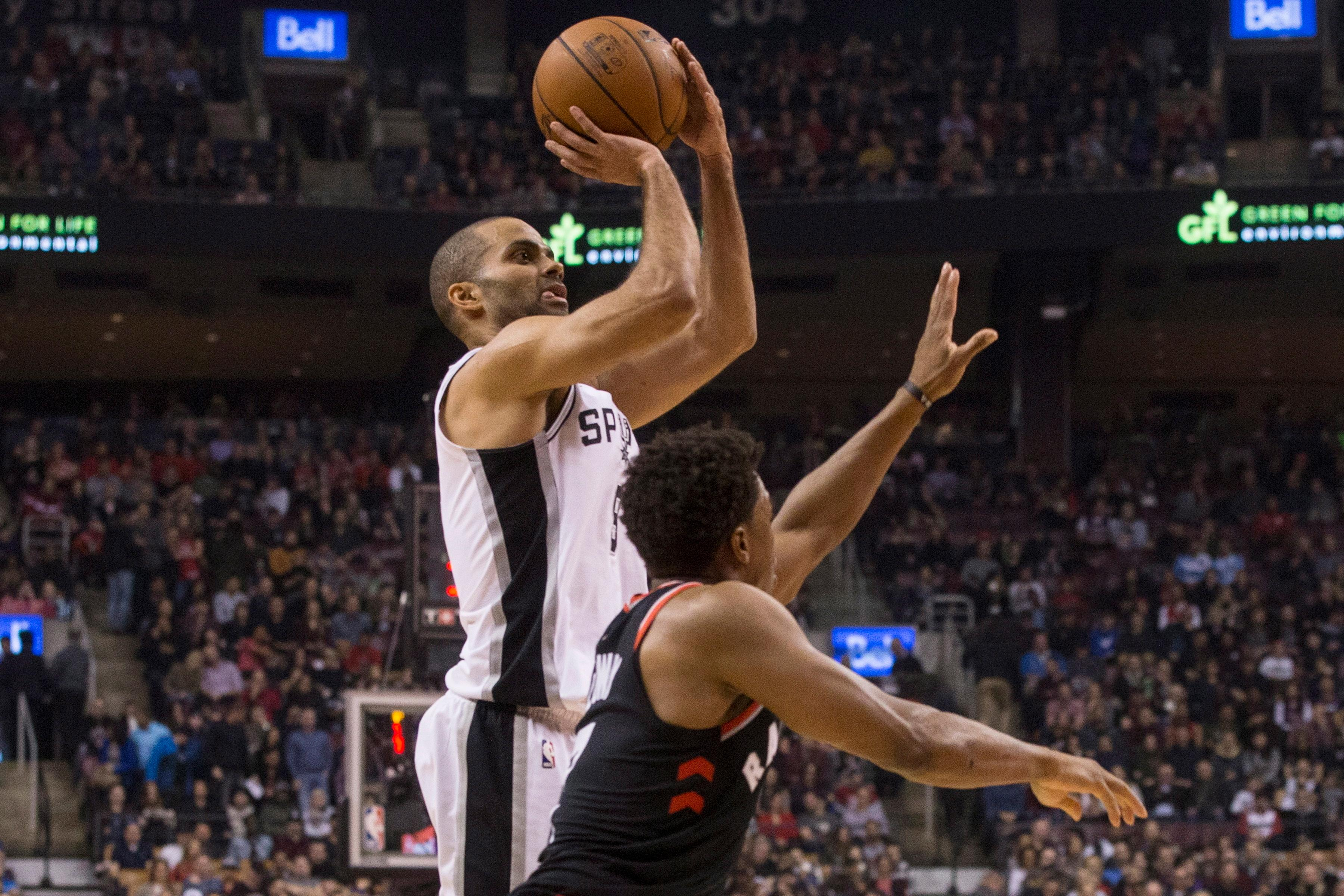 San Antonio Spurs guard Tony Parker (9) shoots over Toronto Raptors guard Kyle Lowry (7) during the first half of an NBA basketball game Friday, Jan. 19, 2018, in Toronto. (Chris Young/The Canadian Press via AP)